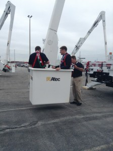 Phill Feltham, Editor-in-Chief of Electricity Today Magazine, ascends new heights in bucket truck, courtesy of Altec